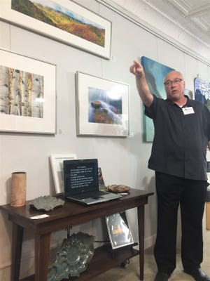 Photographer Larry Bennett presented some of his landscape work at Friday night's reopening of the Art Gallery on Pendleton Square.