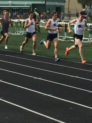 Estero's Hugh Brittenham, Evan Williams and Arye Beck lead the pack in the 1,600-meter run during Wednesday's Class 3A-District 12 track meet at Palmetto Ridge.