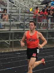 Lely's Josh Wagner completes a lap in the 1,600-meter race Thursday at the Class 2A-District 12 track meet. Wagner won the 1,600 and finished second in the 800, helping the Trojans to a second-place finish in the team standings.