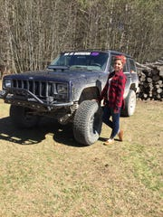Raelynn Terrian shows off her 1998 Jeep Cherokee, which