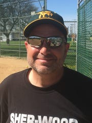 York Catholic softball coach Mark Baum.