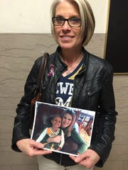 Annette Ellenberger, the mother of Jessica Ellenberger, stands with a photo of her daughter and granddaughter Madyson Marshel outside the courtroom where a jury convicted Patrick Fowler of stabbing the two to death.