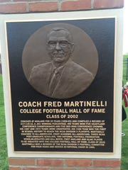 The plaque unveiled on a pillar commemorating Fred Martinelli's coaching career at Ashland University.