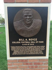 The plaque on a pillar commemorating Bill Royce's playing career at Ashland University.