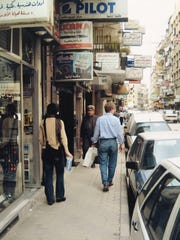 Samar Fitzgerald and Timothy Fitzgerald's dad, Tim Fitzgerald, walking downtown in Aleppo, Syria, in 2004.