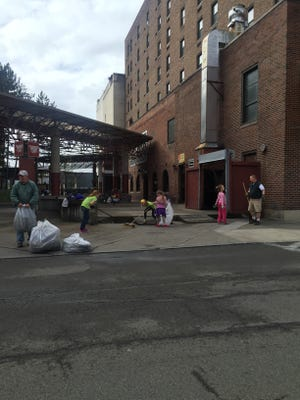 Volunteers pick up the area of Clemens Square during a previous Elmira Downtown Clean-Up event.