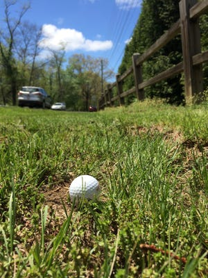 A reader says errant golf shots, like this one that almost reached Swannanoa River Road, are a serious problem.