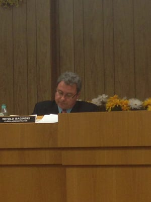 Witold Baginski has been removed as business administrator in Wallington.