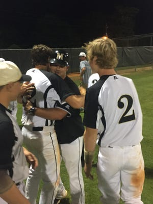 Milton  head coach George Blake celebrates with Justin Whitfield (No. 2) and hugs Logan Smith after the Panthers won 1-0 over Crestview in Tuesday's District 2-7A semifinal.