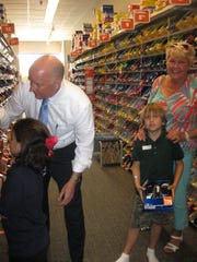 Dr. Mark Rendell helps a student with her selections