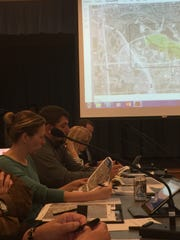 Wauwatosa Common Council members look over phase three of the study done on the future of the County Grounds at a meeting May 2 in the Civic Center at City Hall.