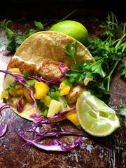 Pan-seared grouper is topped with mango salsa for festive fish tacos.