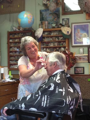 Sylvia Short will celebrate 30 years at the Dryden Barber Shop on Sunday.
