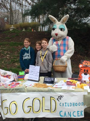 Two Hempsteade boys – James Fuller and Aidan McGraw – organized a booth at the annual egg hunt to raise awareness for ACCO (America Childhood Cancer Organization). Shown are Alex and Hannah Powers, Aidan McGraw, Easter Bunny.