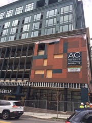 The AC Hotel facade will be getting some finishing touches in the coming weeks, including metal coverings over the concrete, metal mesh over  the window holes and some ornate railings.