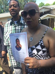 Anita Jenkins holds a photo of her son, Jalen Johnson