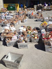 Food from the annual Stamp Out Hunger Food Drive awaits sorting.