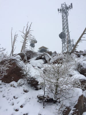 Snowy conditions on Mount Elden near Flagstaff around the time that a 30-year-old man was rescued from the peak wearing shorts and a tank top on May 9, 2017. The hiker said he was trying to win a free pizza.