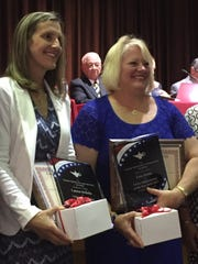 Lauren DeBello (left) and Lisa Arena stepped into the spotlight at Wednesday's school board meeting. They were named the Vineland Administrators and Supervisors Association (VASA) Administrators of the Year.