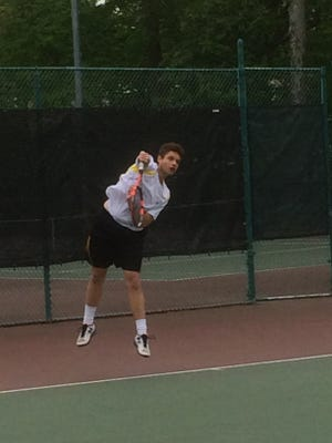 Cedar Grove sophomore Matias Dioses strikes a ball in first singles.