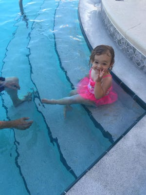 Isabella still can't swim on her own, but she's getting the basics of kicking and moving toward the side of the pool.