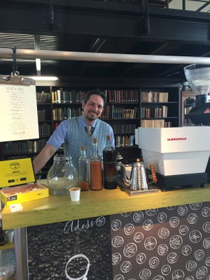 Chuck Pfahler of Adesso Coffee at his drink cart in The Mercantile Library, Downtown