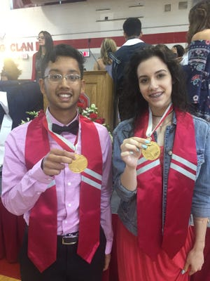 Vineland High School Class of 2017 Valedictorian Neelkanth Patel and Salutatorian Ashley Priore show off the medals they were awarded Thursday during the Moving Up ceremony.