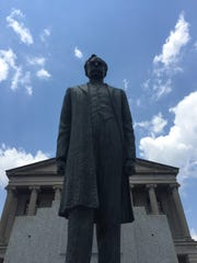 A statue of Edward Carmack stands before the Tennessee Capitol building in Nashville.