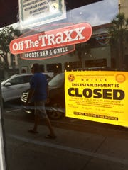 The closed sign on Off the Traxx Sports Bar & Grille.