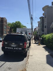 Yonkers police outside 59 Van Cortlandt Park Ave., where they investigated a domestic dispute turned deadly on Sunday.