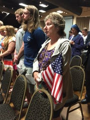 A woman clutches an American flag at this ?Rembering