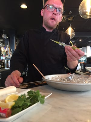 Chef Chip Miller showing off his cucumber mignonette.