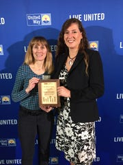 Julie Morin and Tamara Gagne of Perrigo Nutritionals accept the award for campaign of the year at the United Way of Northwest Vermont 2017 Annual Celebration and Community Awards.