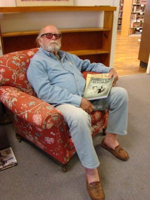 Rich Eastwood, with family roots in Lincoln County is shown with the books he donated to Carrizozo Community Public Library & Archive. The former senior citizens center is now the library, which is also the headquarters of Lincoln County Historical Society.