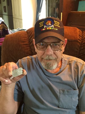 Thomas Lee Rhyner, a U.S. Air Force veteran who served in the Vietnam War, received his lost dog tag through the University of Arizona's TOP Legacy program in 2017.
