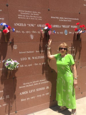 """Gloria Mundy stands next to the crypt of Angelo """"Ang"""" Amato, her uncle who served in the Navy during World War II."""
