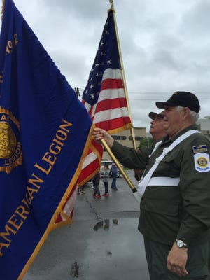 Tom Rathbone and Jim Smith, of American Legion Post 82, hold flags for Endicott's Memorial Day Parade.