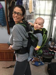 To get some chores done, reporter Victoria Freile will put her son in a hiking carrier inside the house.