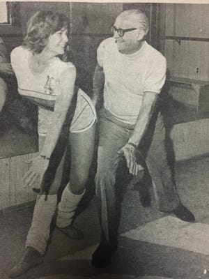 Current Dance Connection owner Lynn Kehlenbeck takes a lesson from previous owner Phil Grassia decades ago.
