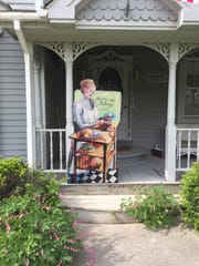 A silhouette depicting 19th-century hat shop owner Alice Jolly created by Brighton Art Guild member Sarah Grusin sits on the porch at Brighton Area Historical Society President Jim Vichich's home, in this photograph he took in June 2017. The silhouette will be installed in front of the White Dress Shop, 209 W. Main St., Brighton, as part of an exhibit celebrating Brighton's 150th anniversary year.