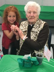 Petway Elementary School kindergartner Alexandra Barriero makes friends with N.J. Veterans Memorial Home resident Evelyn Brown during the students' guest performance on Thursday.