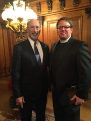 In 2016, Act 16, establishing Pennsylvania's medical marijuana program, was passed and signed by Pennsylvania's governor, Tom Wolf, pictured here with Pastor Shawn Berkebile.