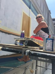 Andrea Townsend, an Indianapolis artist, is working