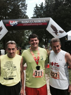 Pete Dodd, Andy Sandrik and Richard Dodd pose for a photo after competing in the Luau 5K/10K at Gifford Pinchot State Park on June 10.