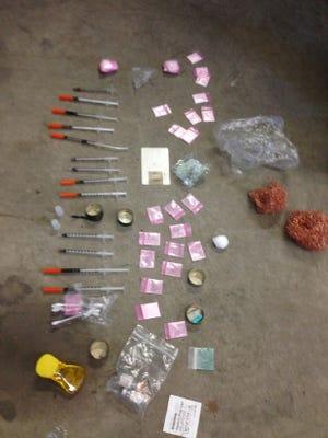 Photo of fentanyl, syringes and other drug paraphernalia.