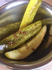 Pickles are delivered to the table with the meal.