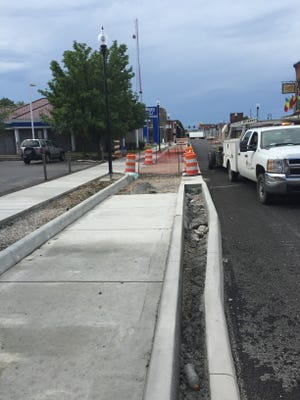 The North Main Street reconstruction project is moving toward its conclusion, but officials have decided to shift a concrete buffer separating the vehicle path from pedestrians. This will result in a slightly wider street and make it safer for buses and commercial vehicles, according to city officials.