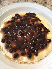 Raisin sauce is spread on the first two layers of this