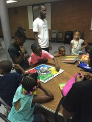 LaDaye Johnson, 32, (standing) organized the Cool Shoes Inc. Summer Camp, which started Monday.
