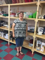 Ann Calvin shows off some of the shelves of household